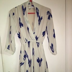 New.  3/4 sleeve tie back blue and cream dress